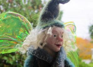 felty fairy holding a felted pumpkin